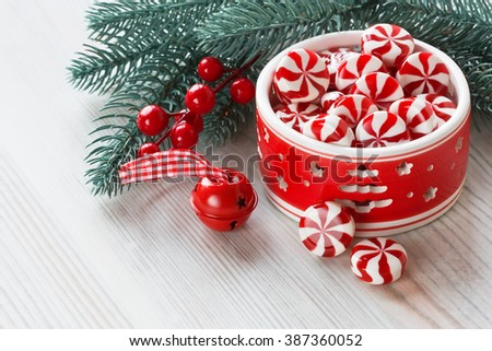 Peppermint sweet candy and Christmas decoration jingle bell and pine branch/Peppermint Christmas candy  - stock photo