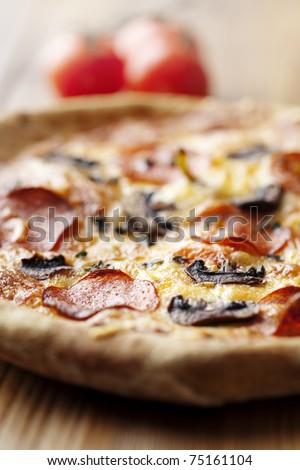 pepperoni and mushrooom pizza closeup, shallow dof - stock photo