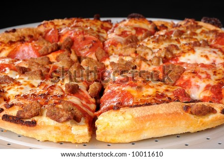 Pepperoni and sausage pizza on pizza baking pan