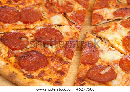 Pepperoni pizza cut into slices