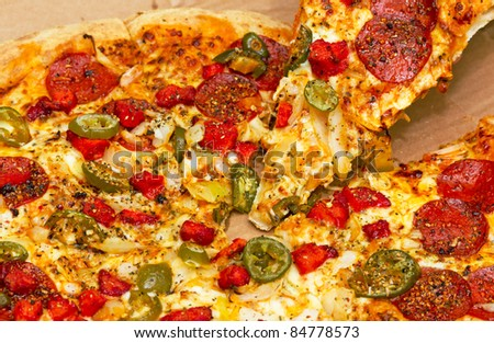 Pepperoni pizza with chicken and jalapeno chilli peppers - stock photo