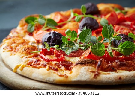 Pepperoni pizza with kalamata olives - stock photo