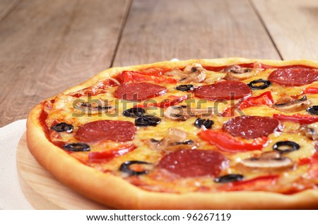 Pepperoni pizza with mushrooms and peppers