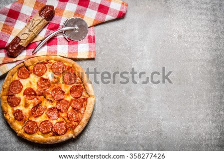 Pepperoni pizza with salami and cheese. On the stone table. Free space for text . Top view - stock photo
