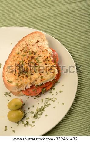 pepperoni sandwich on Italian bread - stock photo