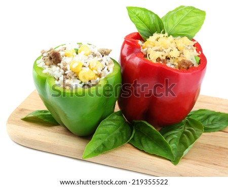 Peppers prepared for cooking stuffed paprika with meat and rice, on wooden cutting board, isolated on white - stock photo