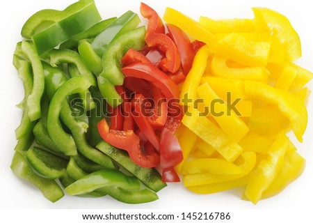 Peppers slices on white background - stock photo