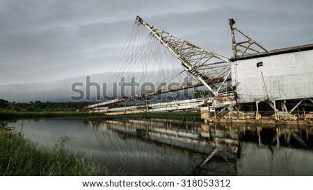 PERAK, MALAYSIA - 13TH OCTOBER 2013; The tin dredge in Batu Gajah along Jalan Tanjung Tualang, Perak is the last witness to the prosperity of tin mining in Malaysia. - stock photo