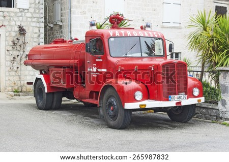 PERAST, MONTENEGRO - MARCH 27, 2015: Red retro fire truck parked in the yard of the fire station, located in the city Perast, Montenegro