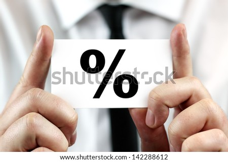 Percent, percentage, interest. Businessman in white shirt with a black tie, shows business card - stock photo
