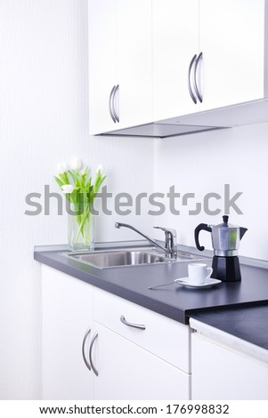 Percolator and one cup of coffee on worktop, kitchen interior - stock photo