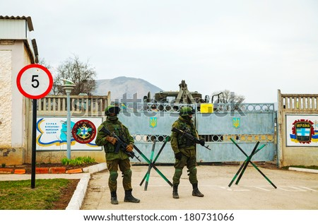 PEREVALNE, UKRAINE - MARCH 4: Russian soldiers guarding an Ukrainian naval base on March 4, 2014 in Perevalne, Crimea, Ukraine. On February 28, 2014 Russian military forces invaded Crimea peninsula. - stock photo