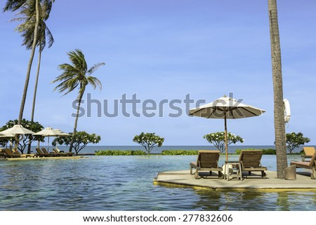 Perfect beach swimming pool with tropical resort relax.