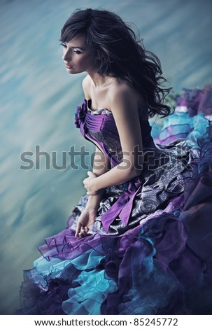 Perfect beauty in a gorgeous dress - stock photo