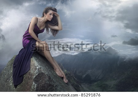 Perfect brunette beauty on a mountain - stock photo