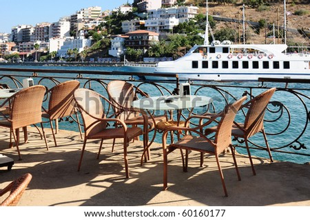 Perfect dinner spot on a terrace in Kusadasi Turkey with a cruise ship in the background