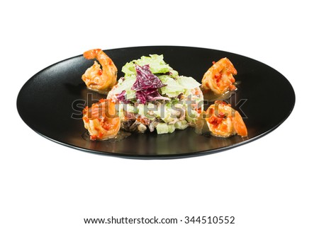 perfect dish with shrimps on a black plate. seafood. Isolated  white background - stock photo