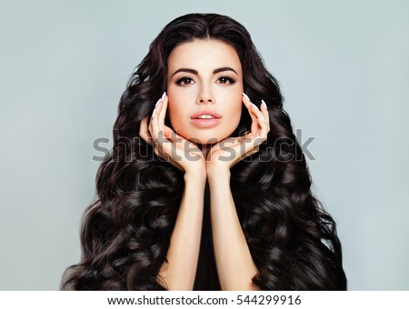 Perfect Face. Young Beautiful Model Woman with Long Hairstyle and Natural Makeup. Spa Beauty. Skin and Haircare concept