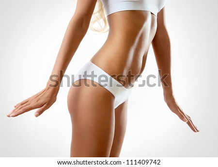 Perfect female body isolated on white background - stock photo