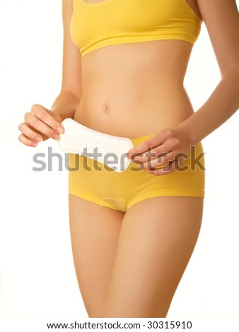Perfect female body isolated on white. Tampon in hands - stock photo