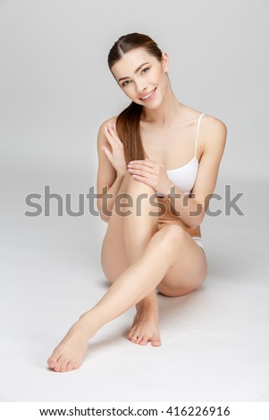 Perfect female legs on grey background