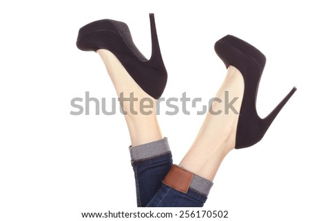 Perfect female legs wearing high heels isolated on white background. - stock photo