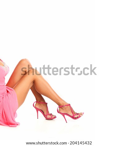 Perfect female legs wearing red high heels isolated on white background,  a lot of copyspace - stock photo