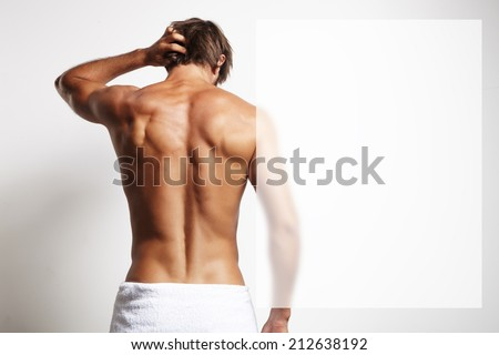 perfect fit man from the back in the towel - stock photo
