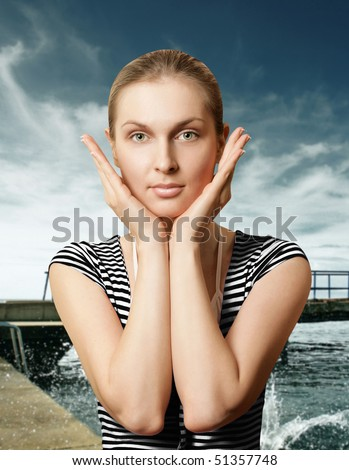 perfect girl with beautiful make up near the sea - stock photo