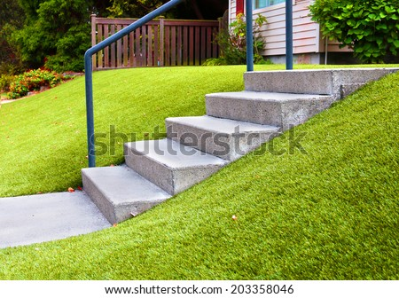 Perfect grass landscaping with artificial grass in residential area - stock photo