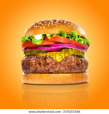 Perfect hamburger classic burger american cheeseburger isolated on colorful orange background