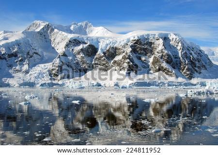 perfect mirror reflection of antarctic sea - stock photo