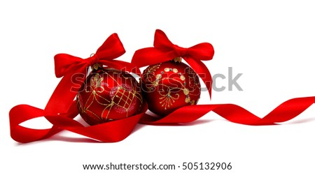 Perfect red christmas balls with ribbon isolated on a white background