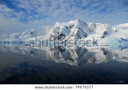 perfect reflection in the ocean of the antarctic peninsula - stock photo