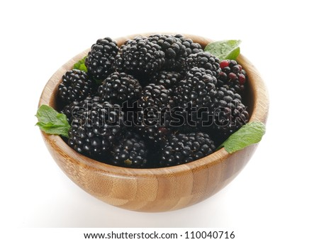 Perfect Ripe Blackberries in Wooden Bowl isolated on white background