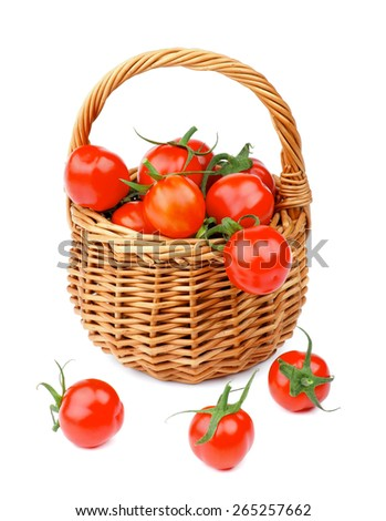Perfect Ripe Cherry Tomatoes with Stems in Wicker Basket isolated on white background - stock photo