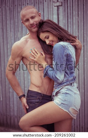 Perfect Romantic Couple Pose, Isolated Gray Wooden Wall. Showing Happiness of Staying Together.