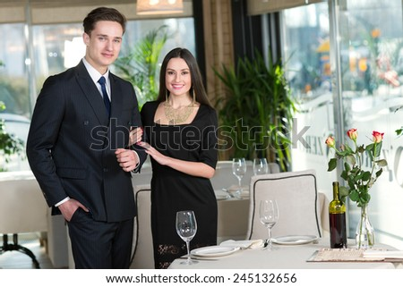 Perfect romantic dinner. Portrait of couple in love came to restaurant for the romantic dinner together - stock photo