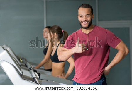 Perfect shape in a gym. Young and handsome African man is having training on a treadmill. Active workout. Healthy sportsmen concept - stock photo