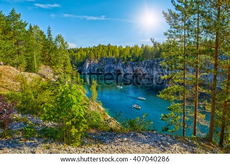 Perfect Sunny Day in Marble Limestone Canyon in Karelia, Russia - stock photo