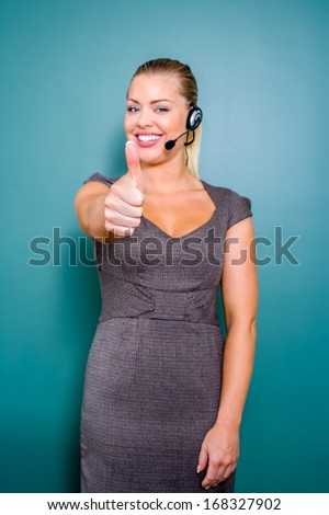 perfect  support with female customer service representative with thumb up - stock photo