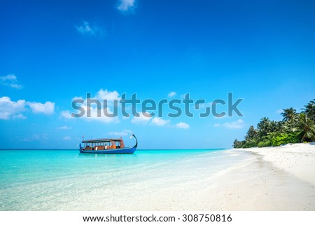 Perfect tropical island paradise beach and boat, Maldives - stock photo