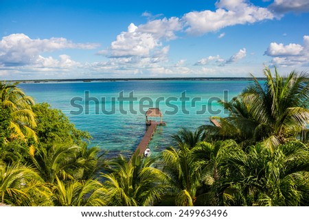Perfect view of caribbean lagoon Bacalar. Seven Color water. Pier and Hut. - stock photo