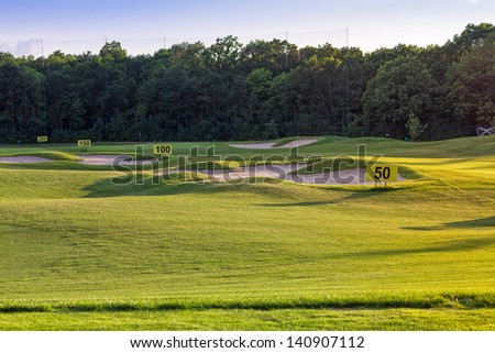 Perfect wavy ground with nice green grass on a golf field - stock photo