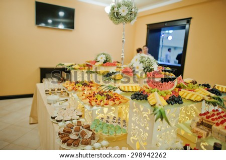 perfect wedding reception table of food and drink - stock photo