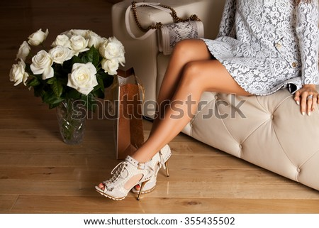 Perfect woman legs with high heels. Holidays and celebrations concept - stock photo