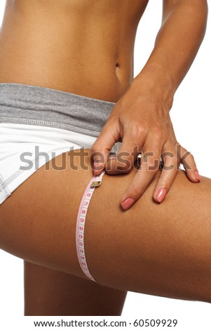 perfect womans legs measure  by metre-stick - stock photo