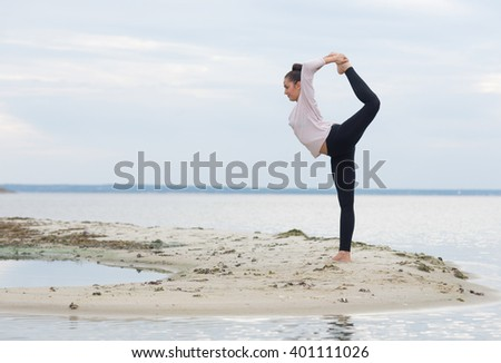 Perfect yoga workout. Beautiful young girl is preparing for doing yoga. Yoga outdoor class workout - stock photo