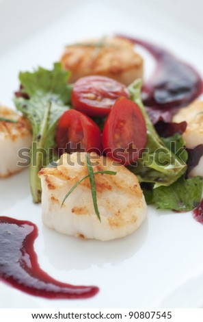 Perfectly seared scallop starter with bright cranberry and balsamic vinegar reduction - stock photo