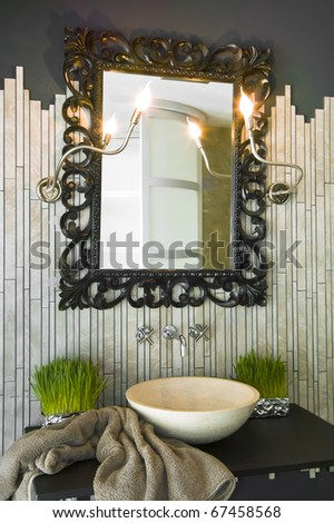 perforated black frame for the mirror over the sink in the bathroom - stock photo